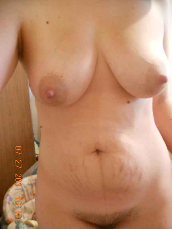 image Fat topless girl covering her boobs with solar oil Part 9
